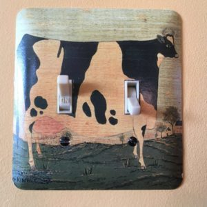 light switch with decoupage of colonial painting of a cow.